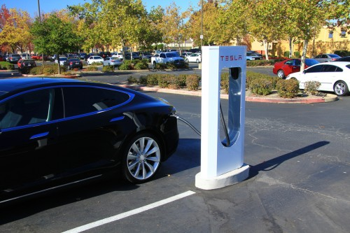 A Tesla Supercharger filling the battery of a Model S at a California outlet mall.