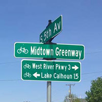 Street sign at Midtown Greenway and 5th Avenue S