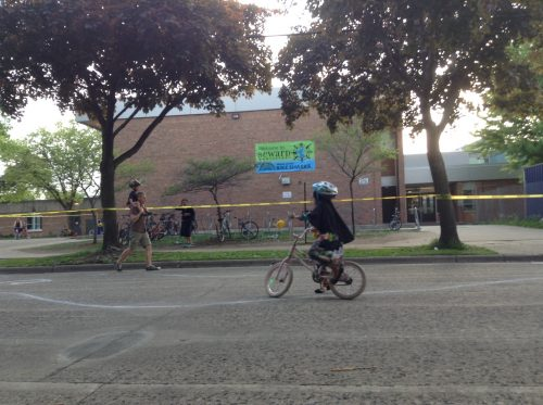 Student riding in front of Seward Montessori School on 29th Avenue