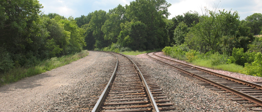 A few hundred yards east of the bridge, looking back towards the bridge line which curves to the left. To the right is a spur that went past Shriners Hospital and up to Franklin Avenue, now mostly abandoned and used as a siding.