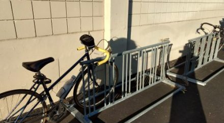 The most miserable bike parking. Visible, but insecure and unwelcoming. (Photo Credit - Dana DeMaster)