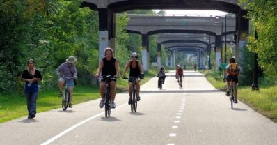 Finding happiness on your bike! Photo courtesy of Rails to Trails.