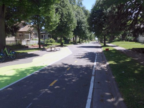 """A street in North Minneapolis closed off to traffic. In theory, it could be """"un-paved."""""""