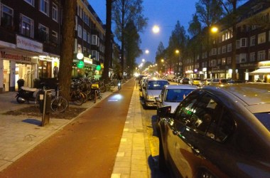Ferdinand Bolstraat, Amsterdam. Café @7 (on the left) has the best scones and clotted cream outside of the UK so I've ridden along here often. It's safe and welcoming for people utilizing any mode of transportation. Outside seating along the sidewalks is quite enjoyable as motor traffic is distanced by people walking, riding bicycles, and parked cars.