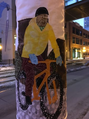 Quilted bicyclist in winter