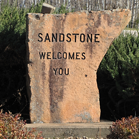 Sandstone welcome sign