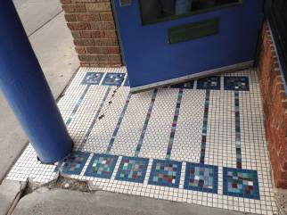 Blues and purples in mosaic squares on a white background, blue door