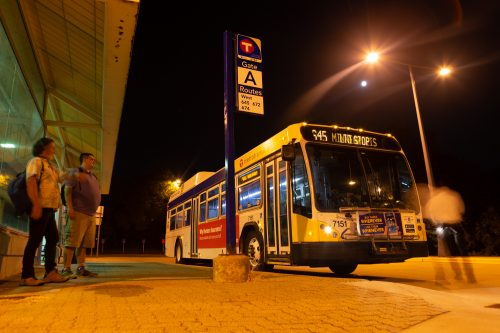 Peter Vader, a Minneapolis resident, and Jeb Rach, a St. Paul resident, wait at the Wayzata Park & Ride for the midnight bus departing Wayzata as the operator prepares the bus for the trip. Over the weekend, Metro Transit eliminated the trip because of low ridership.