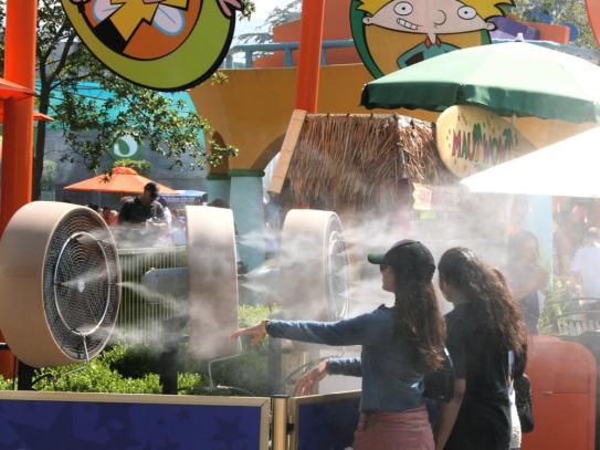 Photo of misting system used to cool amusement park visitors