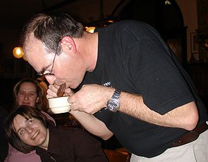 A man performing a Tim Tam Slam.