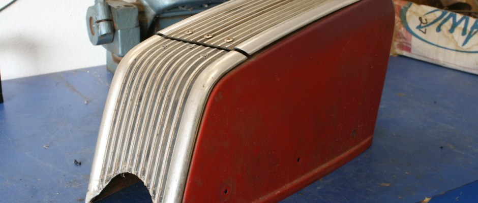 This cool ribbed console came from an early Ford Falcon. It will look right at home in our '63 Mercury Comet wagon project, but first it needs some TLC in the way of polishing. Kinda looks like a toaster.