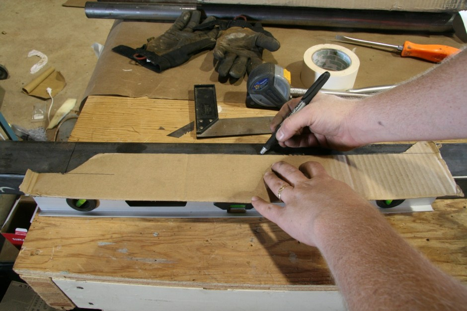 2. Next the template was transferred to the 2x3 14-gauge steel tubing we picked up. Make sure you leave a tab on the rear side to overlap the existing subframe. The front side sill sit flush with front subframe, forming a right angle.