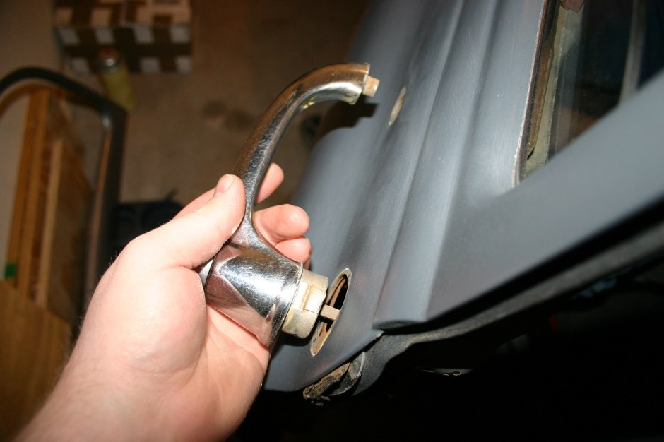 3. Using a flat-blade screwdriver, slide the clip back until the handle comes out. Slide the clip back in place once the handle is out. Be careful not to damage the stripping during this process. A little 3M weatherstripping adhesive can be added keep the stripping from hanging loose.
