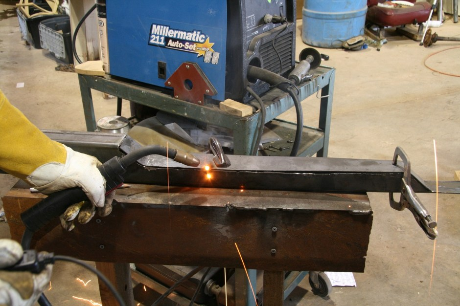 """6. The flat steel was then tack welded in place with our Millermatic 211 MIG welder. The steel is fairly thick at 14 gauge (.0747""""), but warps easily under heavy heat like welding, so we stitch welded it."""