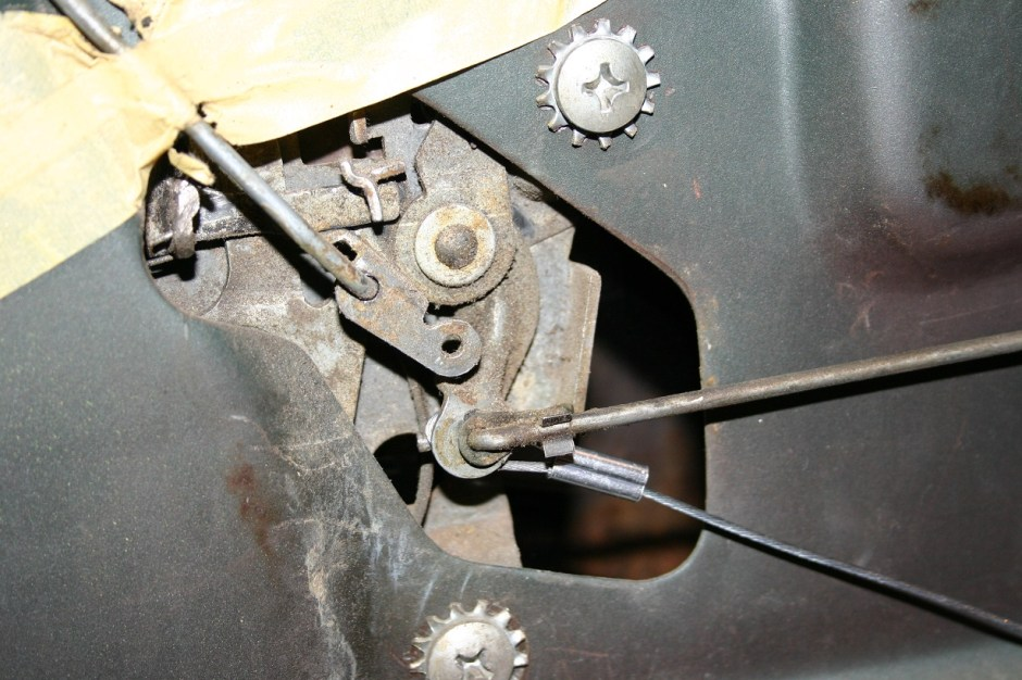 10. Once the solenoid is mounted in place, run the cable to the latch. Loop the cable and crimp the ferrule as before. Make sure the cable has a little slack to allow for flex while driven so the door doesn't open. Also be careful that the cable doesn't interfere with the latch and cause a bind.