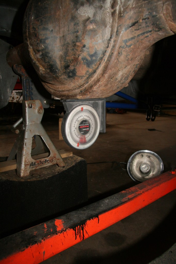 The optimum position for the rear end is 2-3 degrees down angle to the front of the car. This provides the right geometry for the driveshaft rotation. A magnetic angle protractor is really helpful for this project.