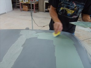 18. The roof was wiped with Duraglass to seal any pinholes in the welds. Once cured, the Duraglass was knocked down with a cheese-grater.
