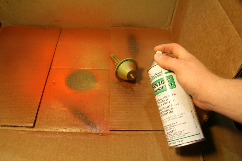 12. Next up is the green tint. This is really thin AND metallic, so it runs fast. You don't need much of this, just a mist. You can place some highlights of green, but we have found that the best method is just a few misting sprays gets the tinting just right.