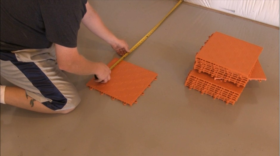 1. The process begins with setting up the corners. If you are covering the entire floor, you can start with the tiles pulled away from the walls a couple of feet and then move them to the walls after the L has been formed. We are setting our tiles about 3.5 feet away from the walls.