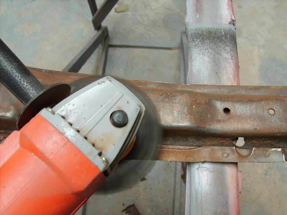 5. A wire wheel was used to remove the scale and rust from the floor supports.