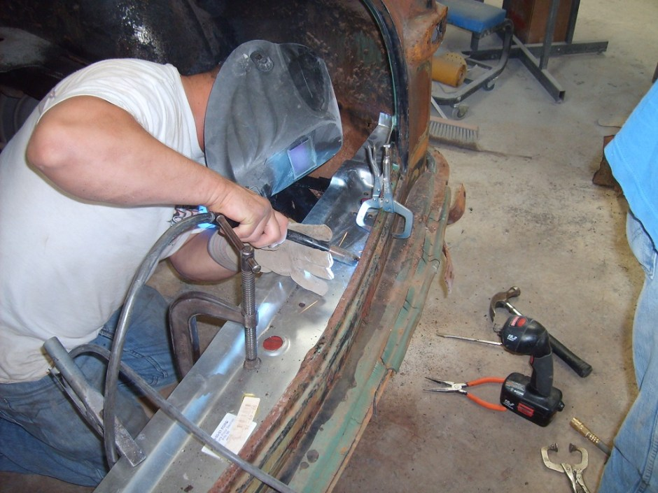 14. Jason Flowers, of Ramsey Autobody, welded up the rear pan to the car. Notice all the clamps; this assures the pan does not move during the welding process.