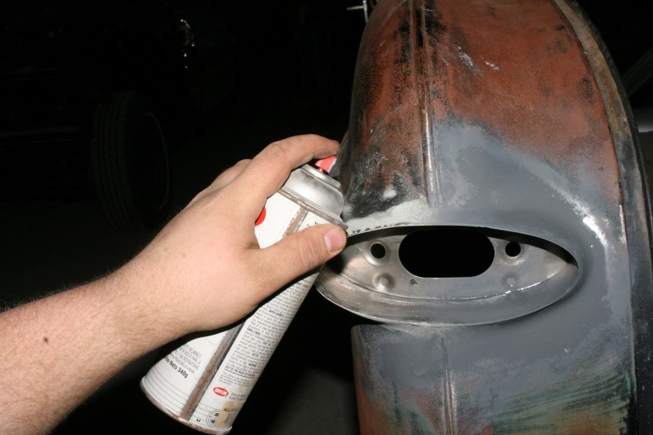 15. We used some rattle-can primer to protect the metal until we complete the body mods on the rest of the car.