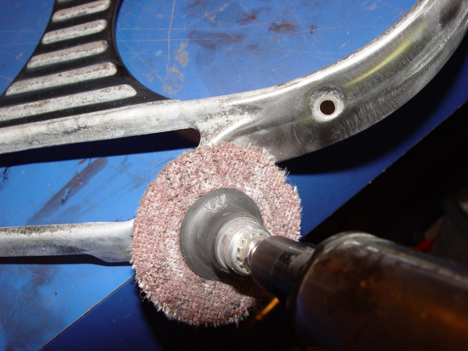 16. Using a die-grinder and a fine-grit scotch-brite pad, buff the part to remove the residue. Pay attention to the corners and edges, as the buffing wheels aren't coarse enough to remove the residue.