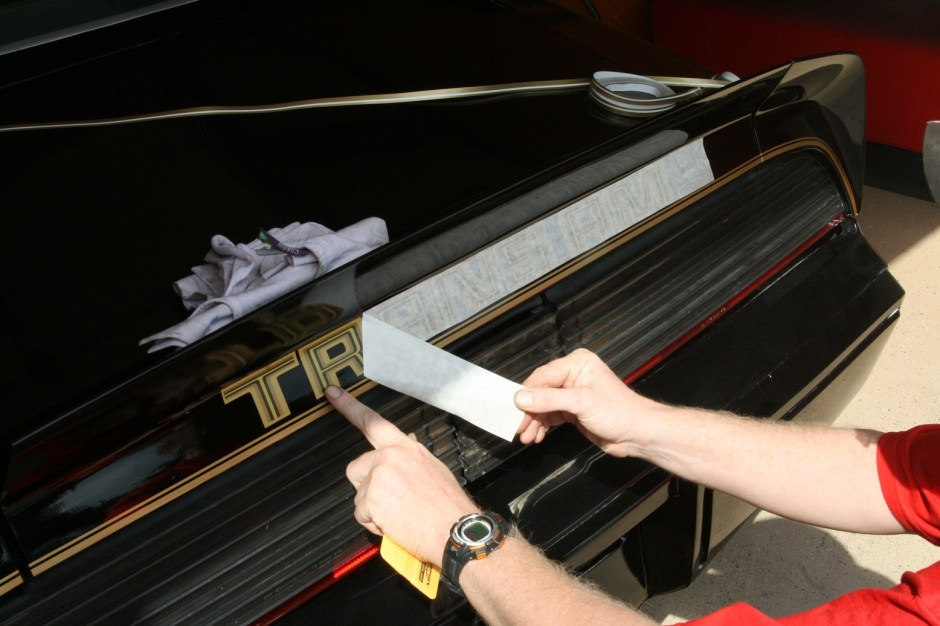 8. After using the squeegee to work the air out, the masking was carefully removed. The vinyl can peel up, so removing the masking slowly works best.