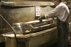 8.Each bumper is washed in a caustic soda bath to remove all of the oils and residue from the buffing compounds.