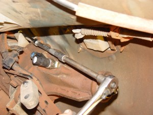 2.The bellhousing is unbolted from the engine. Most of the bolts are easy to get to, but the upper passenger side bolt is a nightmare. We used 5 long extensions and a universal joint to get it out.