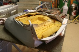 4.The seat cover was wrapped around the foam. This is much easier to accomplish with the steel seat backs removed.