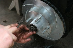 5.The rotor was slid in place and the castle nut tightened. Don't forget the cotter pin.