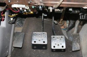 16.The new clutch\brake pedal assembly bolts right up. The clutch cable is self-adjusting, so just hook it up to the pedals and trans and press it down. All done.