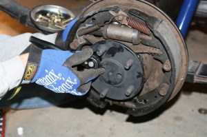 18.Using the factory supplied hole, each nut was tightened on the bolts.