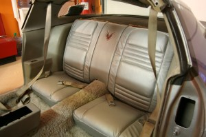 22.The new rear seats were installed in the vehicle. Note the correct embroidered bird in the center of the seat back.