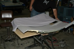 5.Once the console is removed, the work can begin. The ultra suede was laid out on top of the headliner and trimmed with about 3-inches of overlap all the way around. Then it was folded in the middle.
