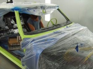 11.The entire car was wrapped with plastic sheeting and painters tape to keep it free from overspray.