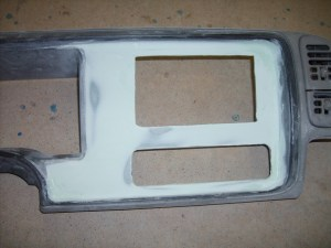 22.Once smooth, the bezel was ready for some paint. Toby used auto paint, which he is set up for, but you can use rattle-can paint. Make sure to keep it to about 3 light coats, letting it cure in between.