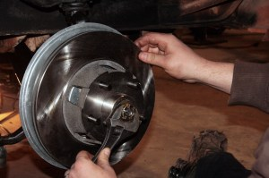 11.The rotor was installed to the spindle. The proper mounting method is to rotate the rotor while loosening and tightening the spindle nut. This helps seat the bearings to the spindle. You want the rotor to spin freely, but not be loose. Don't forget the washer between the nut and the bearing.