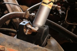 13.The new KYB shocks were dropped into the shock towers. Don't forget to install the isolator bushing.