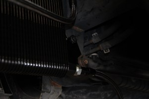Using one of the smaller provided J-clips, the top of the cooler is mounted with a ¾-inch bolt.