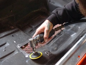 Rubberized undercoating can be stubborn, and wouldn't you know it; this car has it on both sides of the floor. This type of material goes gooey when abraded, but after a while, it gives up and goes away.