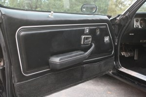 4.The interior is 100% original. Though there may be a few tell-tale signs of wear, like the lower door carpet and door panel vinyl edge, it is only original once. This wear really isn't enough to justify replacement.