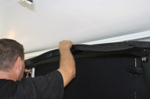 25.The last step is the staple on the front header trim. This is made of a thick round cord wrapped in top vinyl. Just keep it even and clean and you are good to go.