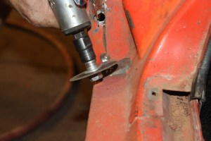 08.A die-grinder and cut-off wheel was used to make the corner transition where the body-ripper cut to the spot-welded section.