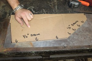11.We made a template from cardboard and then transferred the shape to a piece of 22-gauge sheet metal.