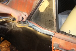 25.We used a DA sander and some 50-grit paper to knock down the glass, feathering it in to the existing metal. You are not looking to level it out, just basic fill.