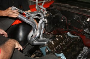 3.We tried to drop the headers in from the top, but no dice. Even with heads off the engine, they won't fit.
