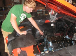 7.Corey Murfin of Redline Auto Sports scraped the block clean for new gaskets. This is important for a proper seal.