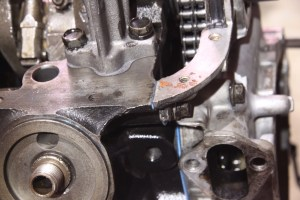 20.The front timing cover is also part of the oil pan seal, so the mating surfaces have to be flush with each other.